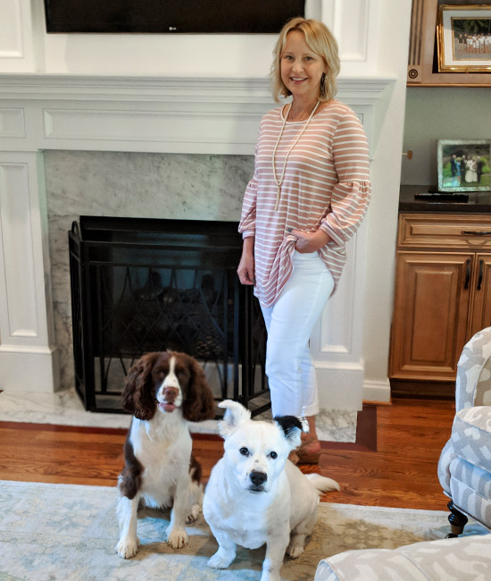 Angie Fowler in her home with her two dogs